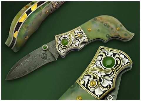 Engraved Jasper folding knife  Ocean jasper (natural mineral from Madagascar) handled liner lock folding knife. Jade accents. Carved and 24K gold overlaid spine. Composite pattern nickel damascus steel blade.   #KhalsaKirpans . . . #Khalsa #Punjab #Singh #Kaur #Sikh #Sikhism  #Turban #Beard #PunjabiWedding #Punjabi #Sardar #Sardari #Sardarni #SikhWedding #Artisan #Sword #Dagger #Blade #BladeSmith #BladeArt #Art #Knife #Weapon #Handcrafted #Spiritual #Satnam #Waheguru #MartialArts…