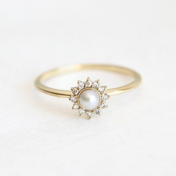 Beautiful pearl ring with prong set diamonds