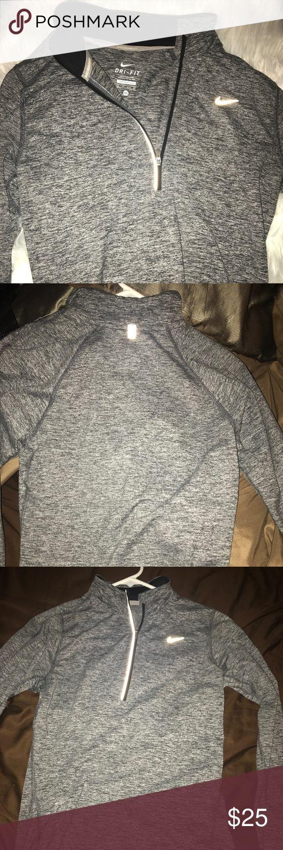 Long Sleeve Nike 3/4 Zip Sweater 3/4 zip sweater from Nike running. Great condition. Multi-colored grey color. Nike Tops Sweatshirts & Hoodies