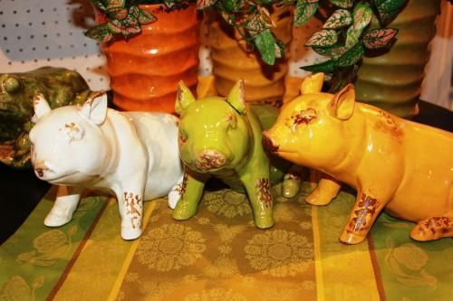 These funky pigs  are ready to add a smile to someone's  day. Glazed ceramic construction in assorted colours