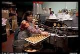 When your in San Francisco, you must visit Ross Alley in Chinatown.  They have a fortune cookies factory there that is a most see.  You can buy fortune cookies seconds and they will give your free sample hot of the presses.  And if you do go, please bring me back a bag of seconds.