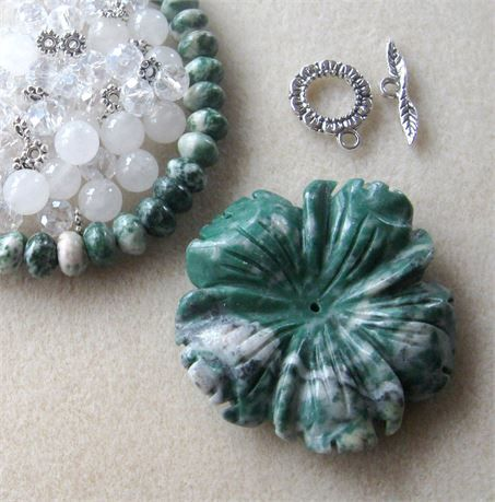 These DIY jewelry kits contain a pendant with coordinating beads and findings so you can easily make a necklace with one stop shopping!    *  tree agate flower pendant, top drilled front to back, also centerdrilled, 53 x 12mm   *  tree agate rondelle beads, 15 strand, 5 x 8mm   *  white glass beads, 8mm   *  snow quartz round beads, 8mm   *  antiqued silver spacers, 6mm   *  antiqued silver designer toggle clasp, 16mm   Each kit comes with 4 crimp beads and 20 inches of beadalon stringing…