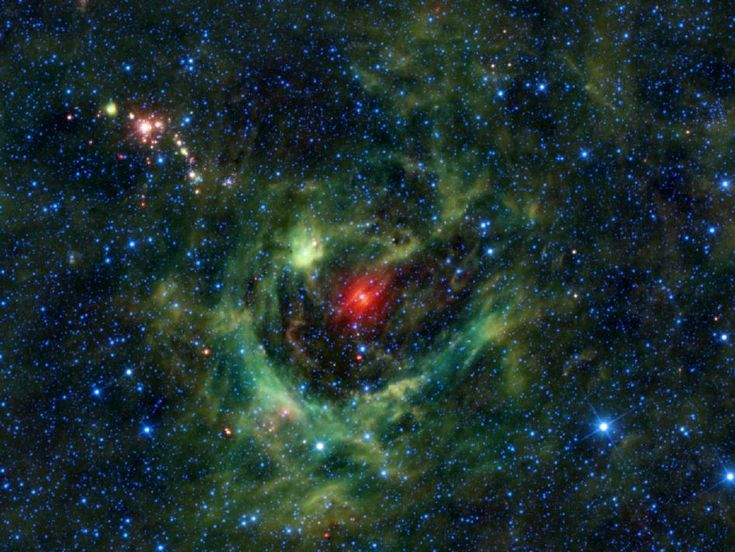 This stellar nursery is made up of a shell of ionized gas surrounding a void with an extremely hot, bright star in the middle.