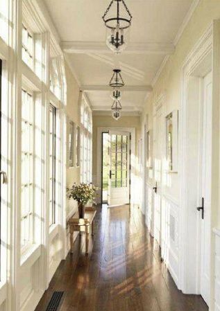 natural light hallway + wood floors - hallway with windows and bell lanterns