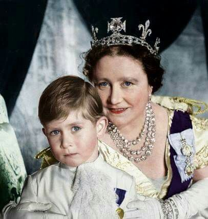 Queen Mother Elizabeth with her adorable grandson Prince Charles ..The photo was taken the day of Queen's Elizabeth II coronation. Her mother is wearing a tiara with the famous Koh-i-Noor diamond, plus the necklace with Queen Victoria's diamonds!