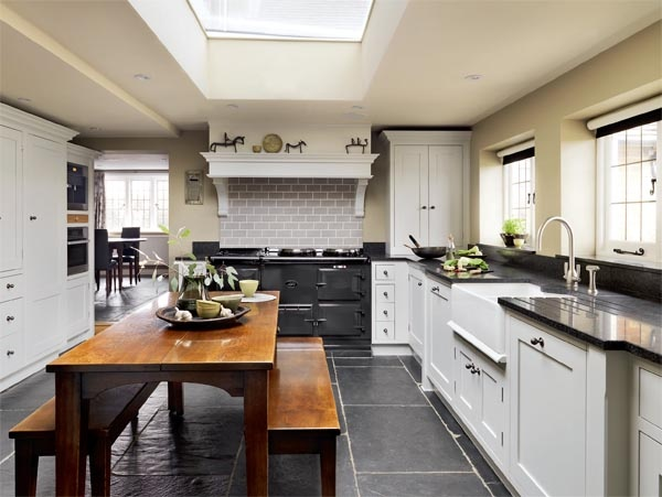 slate floors, white cabinetry & charcoal appliances. [from period living]