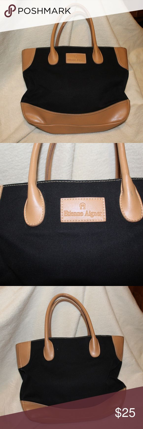 Etienne Aigner black and brown purse Measurements are approximate Width: 3 inches Length: 12 inches  Height:  10 inches  Offers always welcome Etienne Aigner Bags