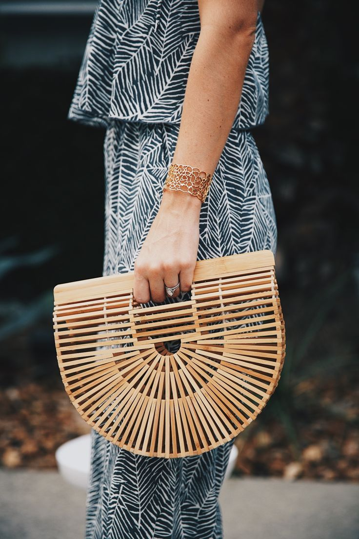 DTKAustin shares details on one of her go-to women's boutiques; Red Dress Boutique along with this beautiful palm print jumpsuit and Japanese bamboo bag. | how to style a jumpsuit | how to wear a jumpsuit || Dressed to Kill