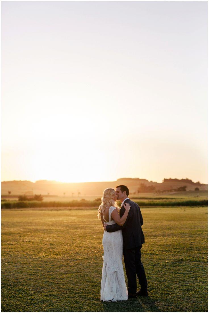 www.vanillaphotography.co.za | Durban weding photographer, Durban wedding venue, Collisheen wedding venue, Ballito wedding venue, bridal shoot, lace wedding dress, groom navy suit, bride & groom, sunset, kiss