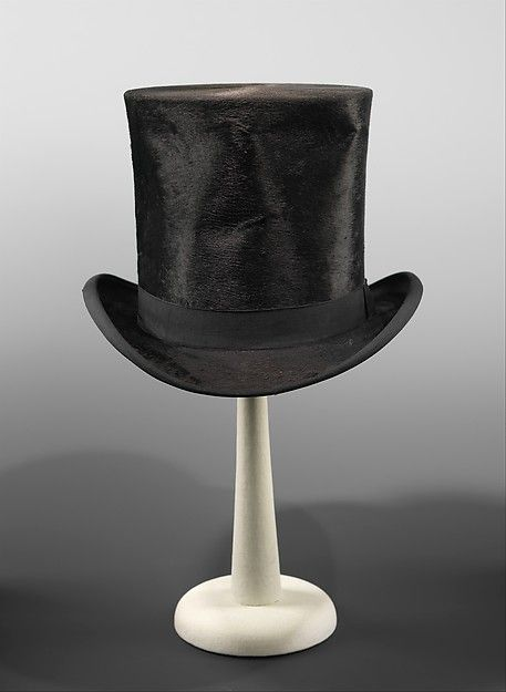 Top Hat. British made from a designer Melton. Dating back to 1875. Made from silk. Found at the Metropolitan Museum of Art.