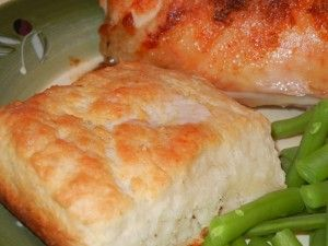 7-Up Biscuits - Cut 1/2 cup sour cream into 2 cups Bisquick.  Add 1/2 cup 7-up.  Makes very soft dough.  Sprinkle some biscuit mix on board or table and pat dough out.  Melt 1/4 cup butter in 9 inch square pan.  Place cut biscuits in pan and bake at 450 deg until golden brown.