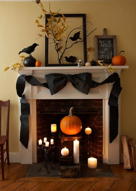 Amazing spooky halloween mantel decoration and design with a large black bow and spooky bats, crows   pumpkin, banner, spooky, kids, fall