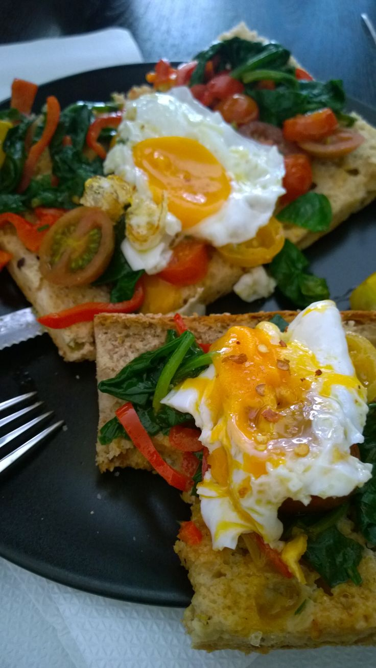 Healthy and filling breakfast with eggs and vegetable on lagana (type of Greek flatbread).