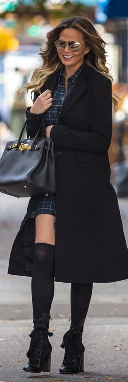 Who made Chrissy Teigen's lace up boots, black coat, handbag, and gold aviator sunglasses?