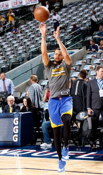 Stephen Curry of the Golden State Warriors warms up before the game against the Dallas Mavericks on March 21 2017 at the American Airlines Center in...