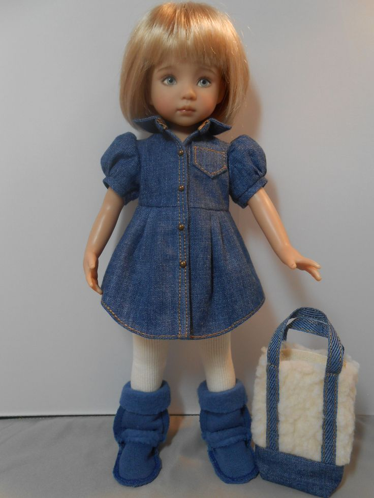 The little effner doll is wearing a prewashed denim dress. It has tan triple stitching for trim. There are four studs down the front with snaps behind them. Her cream color leggings have elastic in the waist. SOLD for $112.50 on 11/14/14.