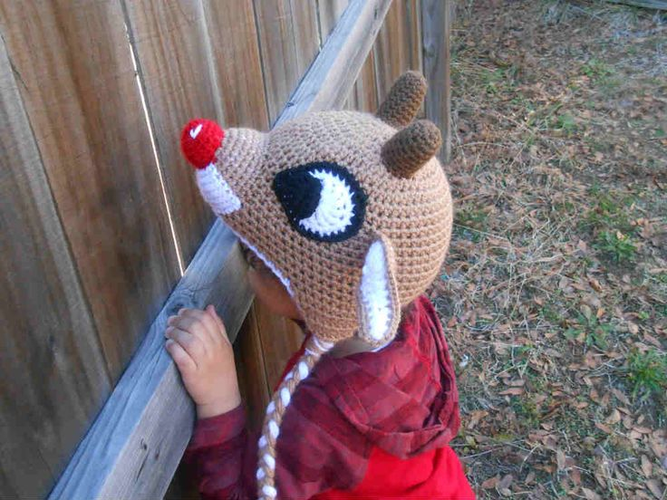 Get this free Red-Nosed Reindeer crochet hat pattern at CrochetCauldron.com. The perfect Christmas crochet pattern for both kids and adults!