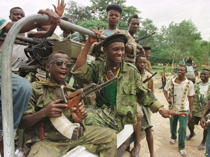 Liberia Civil War | RUF ( Revolutionary United Front ) soldiers ride in a pick up truck at ...