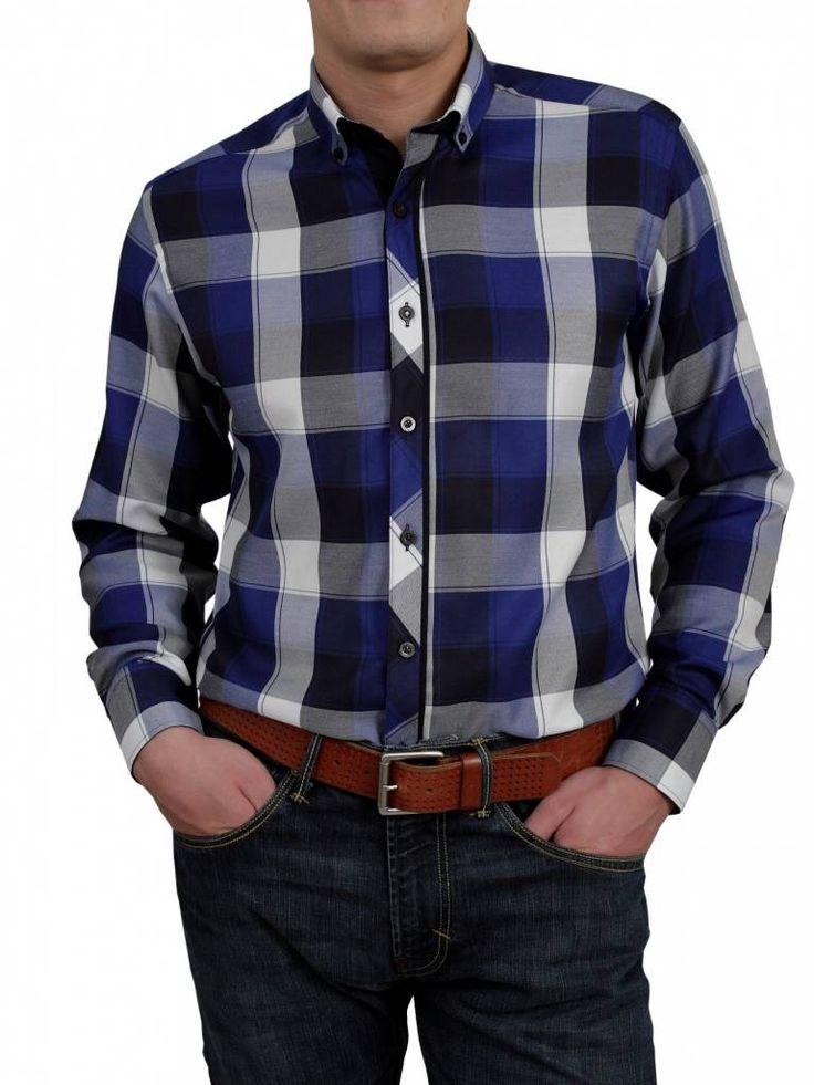Een mooi blokjes overhemd van het merk Vegea met de kleuren blauw,zwart, wit en grijs.