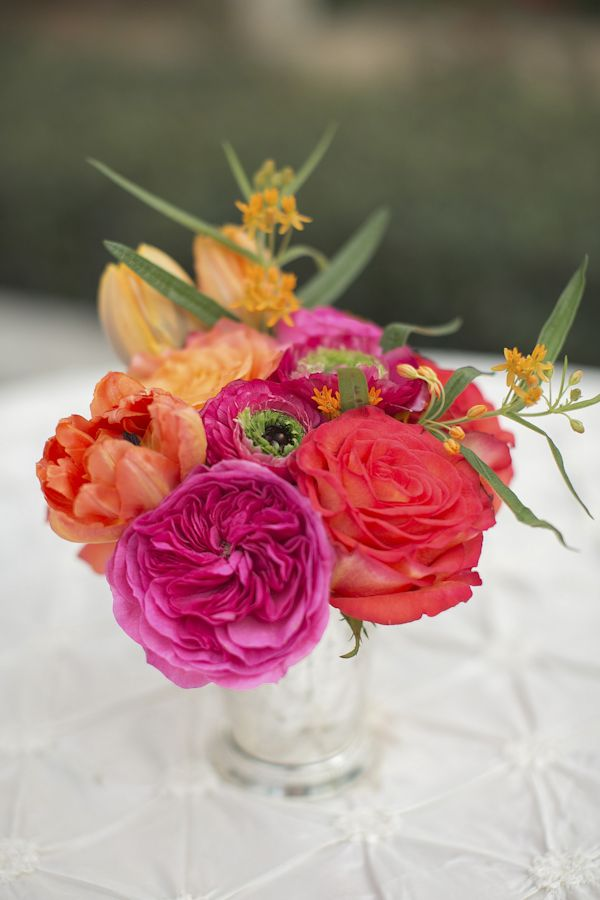 Brightly colored centerpiece for Christopher Confero designed wedding, photo by Wynter Photography | via junebugweddings.com