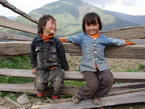 national geographic children of the world | Brother and sister in Bhutan's Phobjikha Valley.