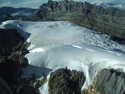 Ice-covered TROPICAL mountain? Yes! Puncak Jaya, Papua, Indonesia..\.