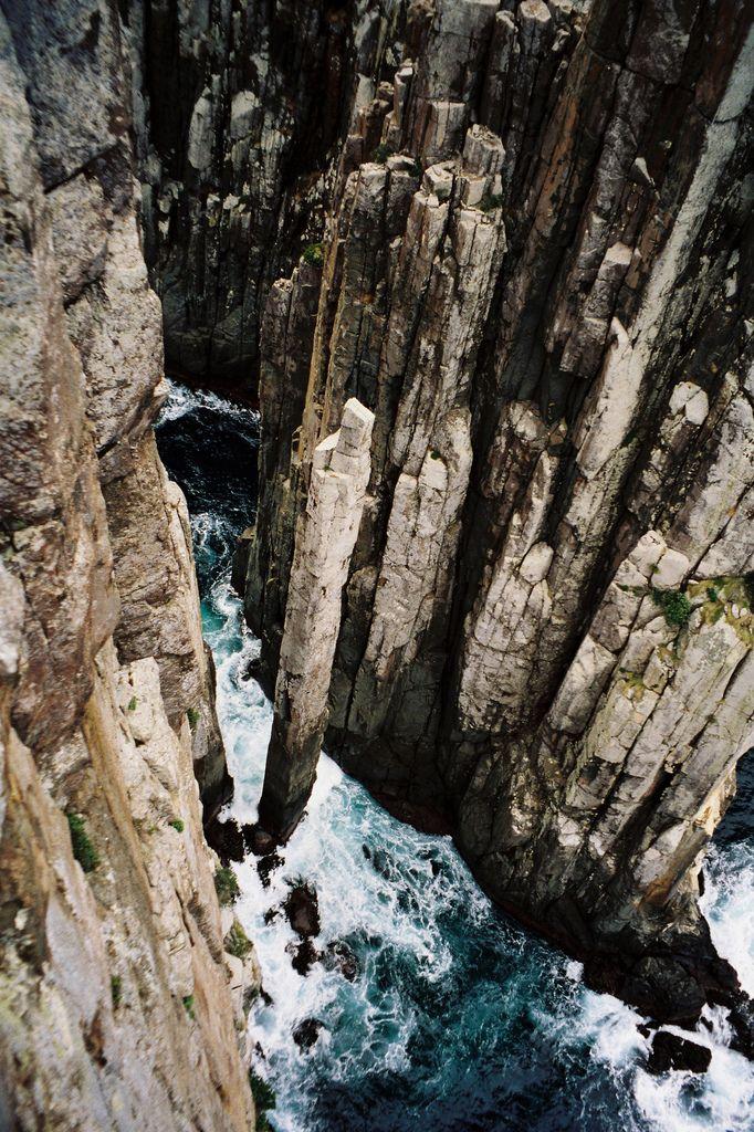 Dolerite columns and sea stacks, including the vertiginous totem pole, at Cape Hauy, Tasmania.