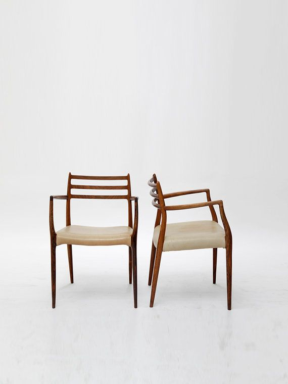 A pair of rosewood carver chairs, upholstered with rare tan leather, designed by N.O. Møller.  Model 62. Designed 1962. Manufactured by J. L. Møller,