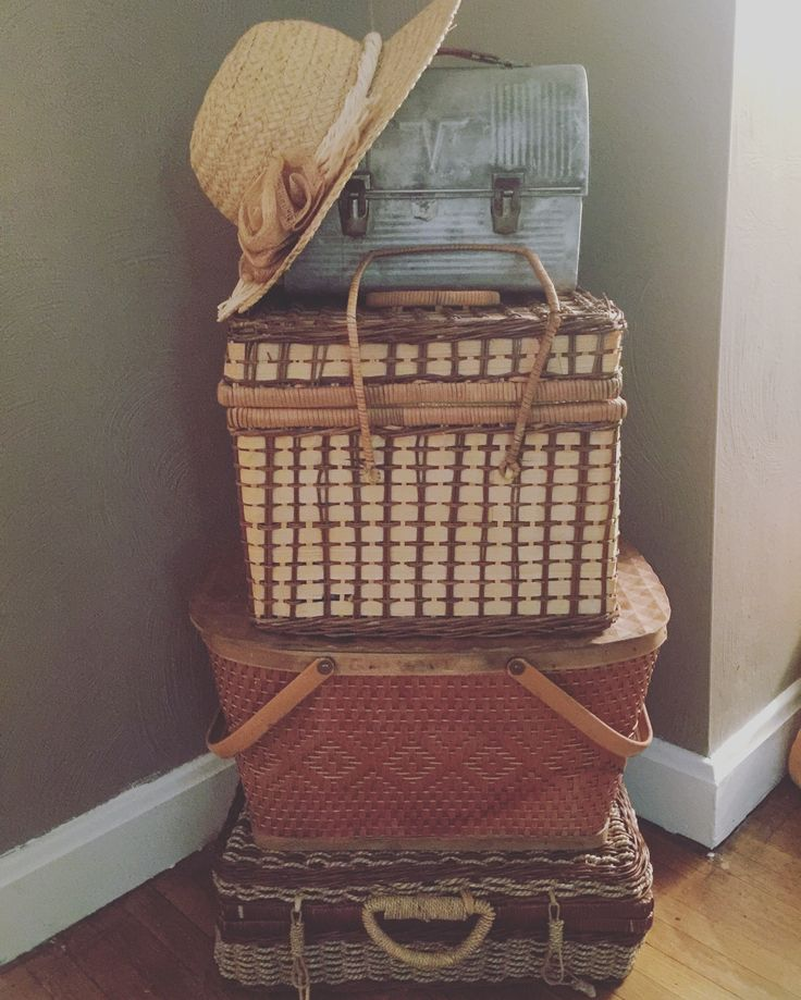 Simple cheap farmhouse style decor stack picnic baskets makes a statement