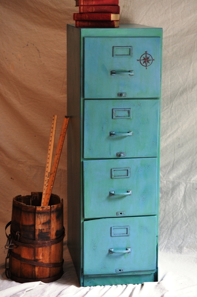 Paint an ugly old metal file cabinet and make it into this! Like the colors.