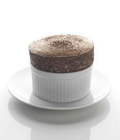 A chocolate soufflé is a classic way to round off a lavish dinner. Crack the surface with a spoon and pour in cream or add a scoop of ice cream to serve this chocoholics paradise - Daniel Clifford