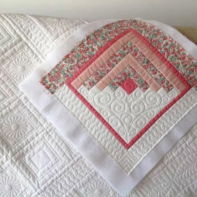 Log cabin style quilt block with colour on 1 side …