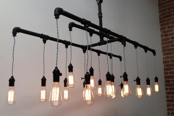 Great looking pipe chandelier. Available in silver or charcoal pipes.Available in different sizes. Price is for the standard size you see in the picture. Availa