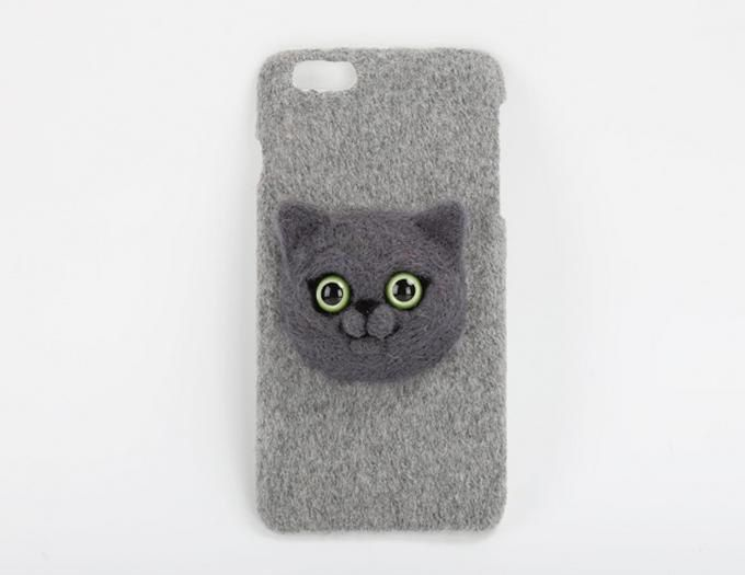http://sosuperawesome.com/post/155451776603/needle-felt-phone-cases-and-purses-by-elves-in