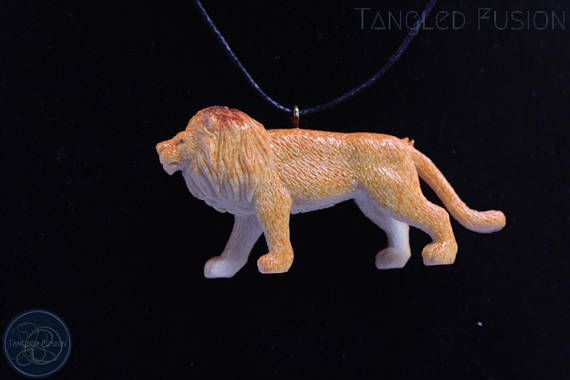 Quirky Handmade Adjustable Animal Necklace on Leather  Design: Lion       Tangled Fusion offers a wide scope of quirky, fun jewellery and handmade creations.  https://www.etsy.com/au/listing/536750735/quirky-handmade-adjustable-animal?ref=shop_home_active_3