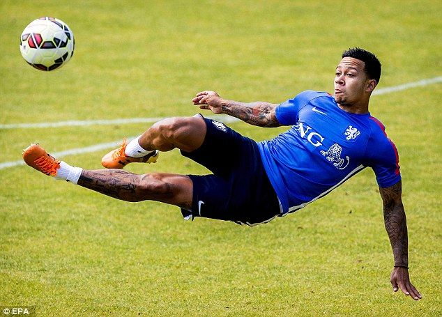 New Manchester United signing Memphis Depay attempts an acrobatic scissor kick