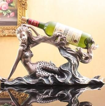Mermaid Wine Rack Figurine $32.10 www.mermaidhomedecor.com