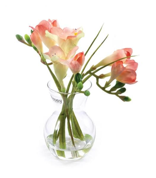 Freesias and leaves in a pristina vase, set in Still Water™. Pink. Height 20cm. €18.50
