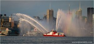 FDNY Fireboat patrolling the waters around Manhattan, NY #FDNY #NYC #fire #setcom #HudsonRIver #spray #water http://setcomcorp.com/marine-integrated-seat-communications.html