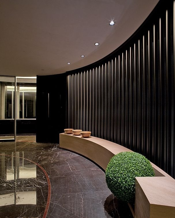 Curved elegant seating system in reception reception for Elegant hotel decor