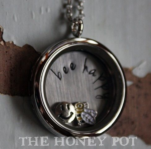 "HPKJD Bee Happy Locket - The Hive NZ - A buzzing online shopping experience. Gorgeous stainless steel floating locket featuring a back plate stamped with ""bee happy"".  Includes 2 floating charms, a smiley face and a bee. A cute pendant to bring a smile to someones face.   Please allow 1-2 weeks delivery time   Price INCLUDES courier for residential properties and NZ post for Rural addresses."