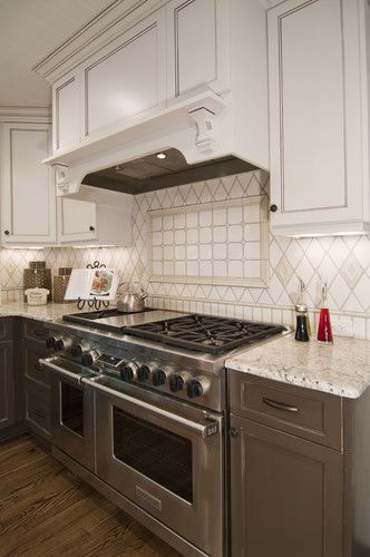 the stove, backsplash, hood, colors, look - needs marble countertops ...