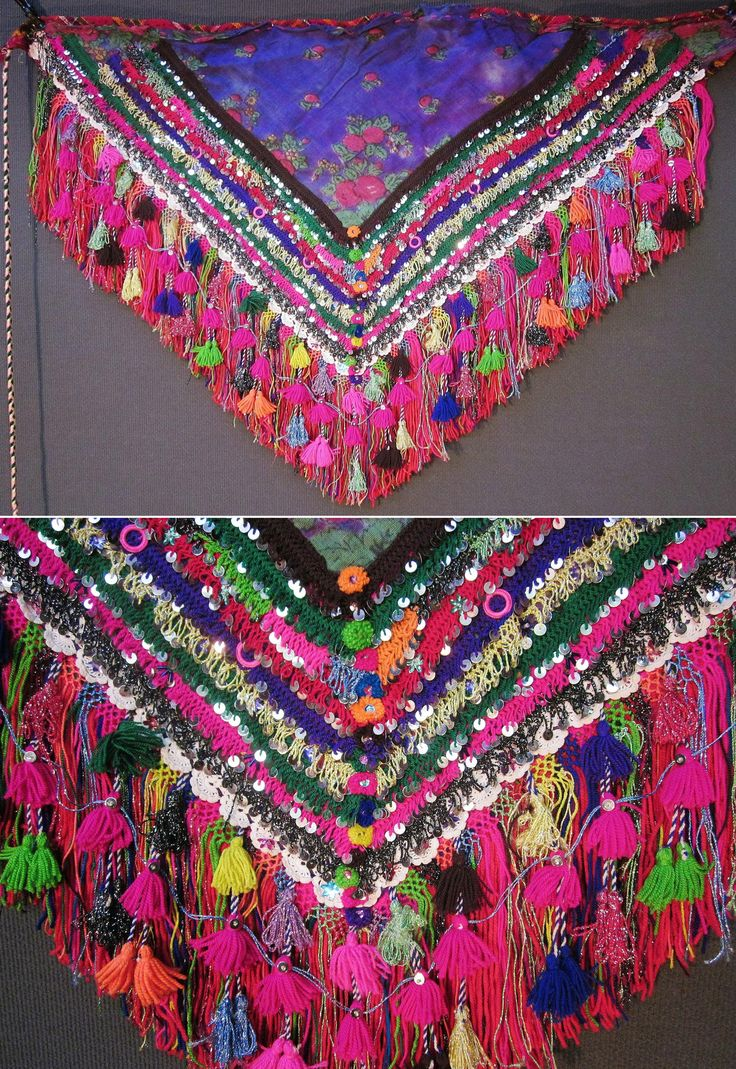 An 'arkalık' (waist cloth)  from the Pomak villages near Biga (Çanakkale prov.).  Part of the traditional festive costume for women.  1950-1975.  The triangular printed cotton fabric is adorned with cotton crochet lace & interweaving, (cotton or orlon) pom-poms & tassels, and lots of sequins (both metal and mica).  (Inv.nr. ark028 - Kavak Costume Collection - Antwerpen/Belgium).