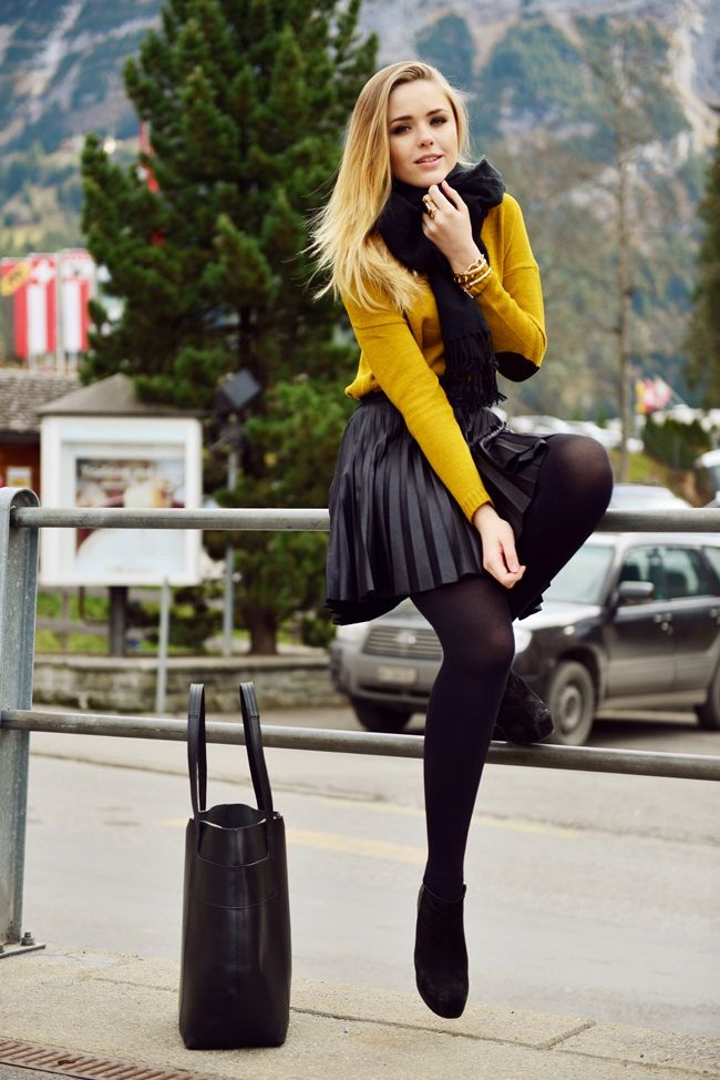 Black tights, shiny dark grey pleated skirt and mustard colored wool sweater