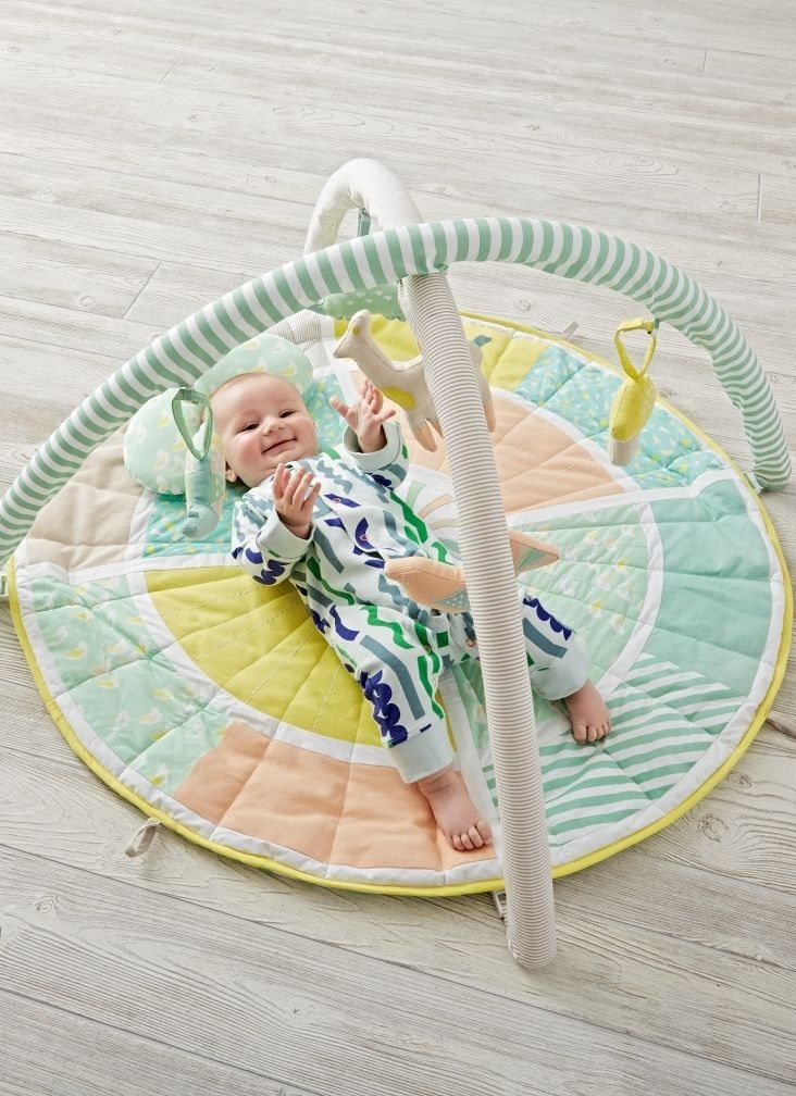 Shop Blooming Baby Activity Gym.  Soft and brimming with bright colors and patterns, our Blooming Baby Activity Gym is always ready for playtime.  Your little ones will love to touch and explore the plush mat and play with the soft rattles.