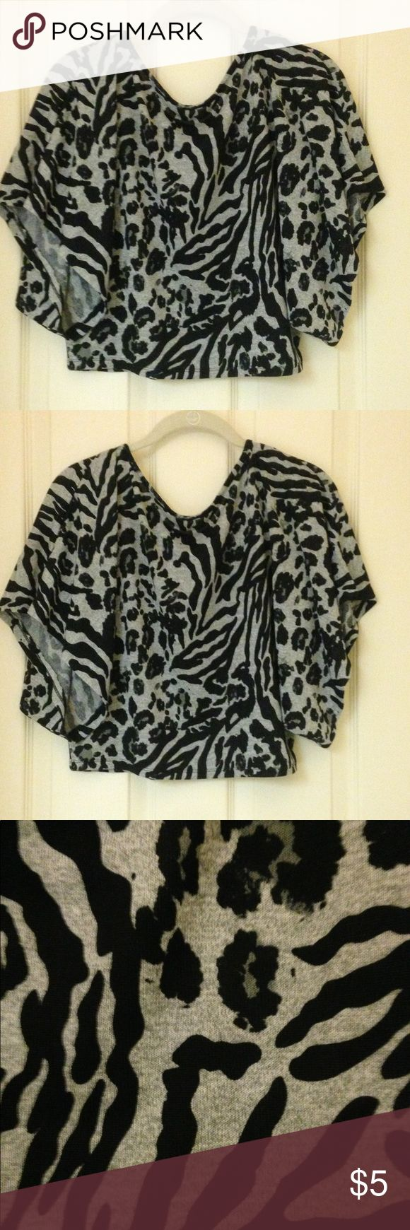 Animal Print Dolman Style Crop Top Black and Gray Animal Print Crop Top. Size L. Measurements are Length 17, Bust 18 and the bottom of the Crop opening is 18 inches across. Excellent Condition. No tags. Tops Crop Tops