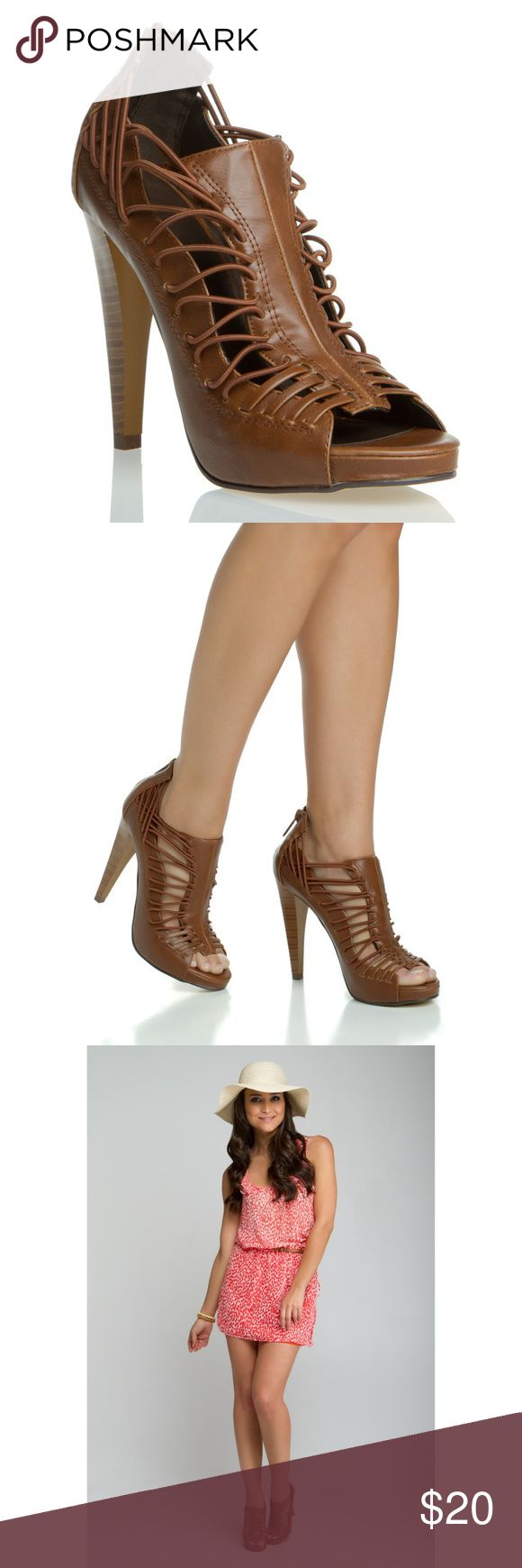 """Brown Strappy Heels So easy to dress up or down an outfit with these heels! The straps are stretchy cords and the panels show hints of skin! Only worn once or twice with minimal signs of wear. Zip up closure on back and heel height measures 5"""" Shoes Heels"""