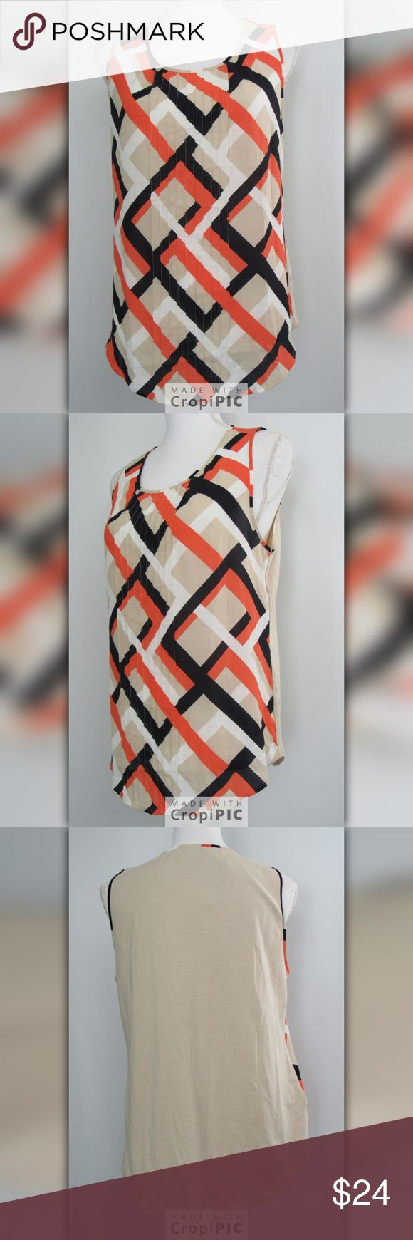 """Ann Taylor Cami tank New Size Medium Ann Taylor Womens Medium New Sleeveless Camisole Tank top $54 Nwt Orange Black  Approximate Measurements (measured laying flat and in-stretched) • Armpit to armpit: 18"""" inches • Hips flat: 21"""" inches • Length from shoulder to very bottom: 26"""" inches  Shipping Your order will be on its way to you within 1 business day of receiving payment  (Monday-Friday). Ann Taylor Tops Camisoles"""