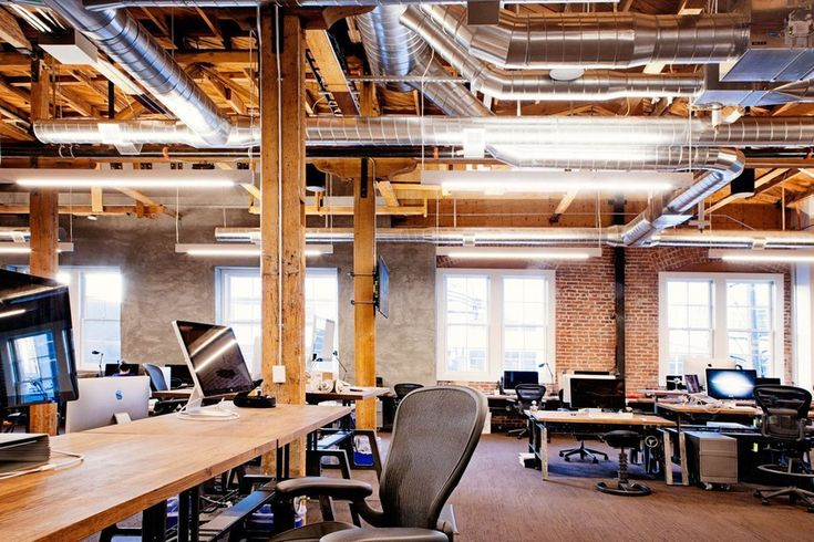 Open-source software startup GitHub enlisted the Custom Spaces design collective to deck its open plan office with gleaming wood and exposed brick.