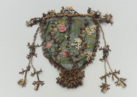 Round drawstring bag Possibly Greece, 19th century Dimensions 14.5 x 15.5 x 1.2 cm (5 11/16 x 6 1/8 x 1/2 in.) Medium or Technique Silk net with silk bibila lace, gilt metal thread and tassel, and silk cord